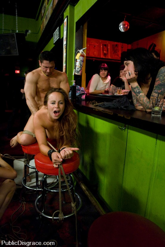 Kink 'Busty brunette fucked in front of a bar full of people!!!!' starring Bella Rossi (Photo 1)