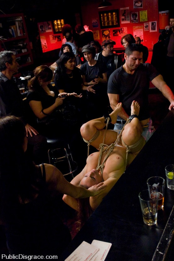 Kink 'Busty brunette fucked in front of a bar full of people!!!!' starring Bella Rossi (Photo 15)