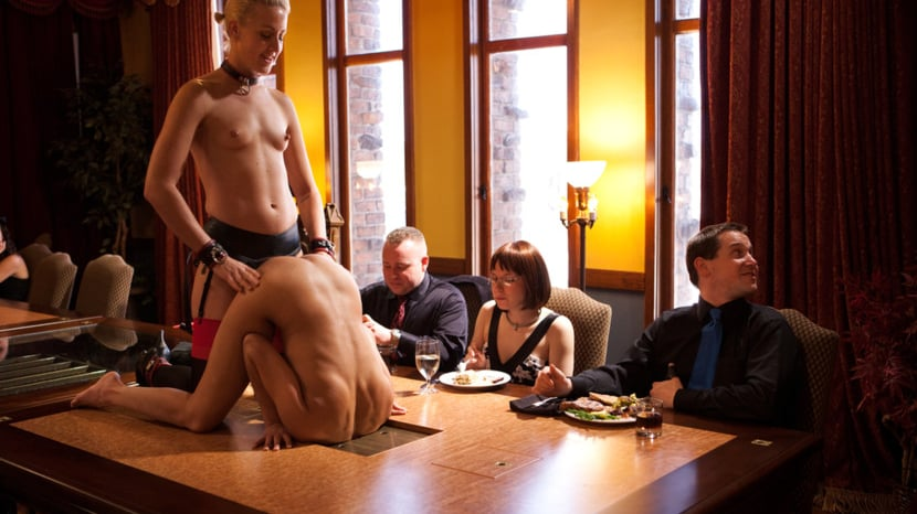 Nude serving dinner