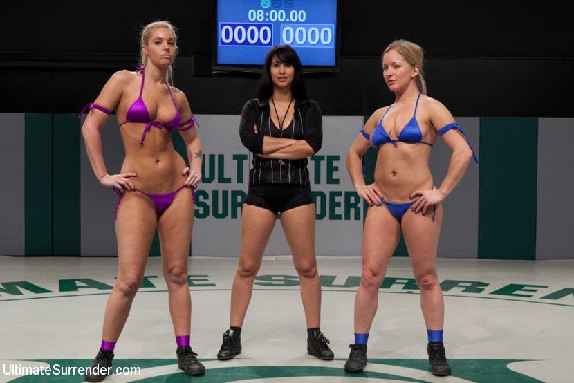 Kink '2 blond Amazons battle. Smaller girl destroys bigger. Fingers her on the mat then fucks her.' starring Hollie Stevens (Photo 2)