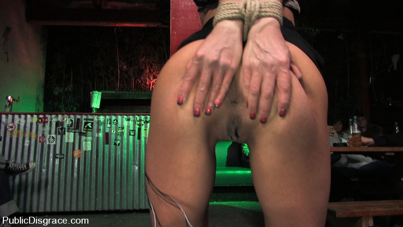 Kink 'Beautiful brunnette, Jade Indica, is bound and fucked in a crowded bar' starring Jade Indica (Photo 14)