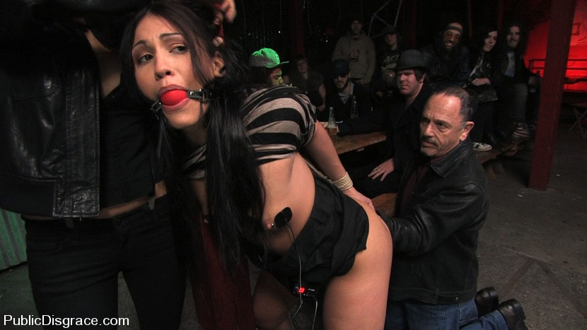 Kink 'Beautiful brunnette, Jade Indica, is bound and fucked in a crowded bar' starring Jade Indica (Photo 15)