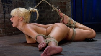 Lea Lexis in 'Former Romanian Gymnast puts her flexibility to the test as she is brutally bound on the floor.'
