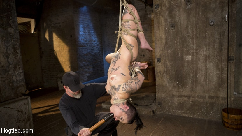 Kink 'Tattooed Pain Slut Endures Brutal Bondage with Agonizing Torment' starring Leigh Raven (Photo 4)