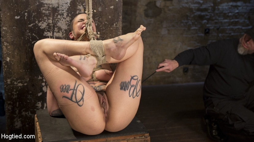 Kink 'Tattooed Pain Slut Endures Brutal Bondage with Agonizing Torment' starring Leigh Raven (Photo 11)