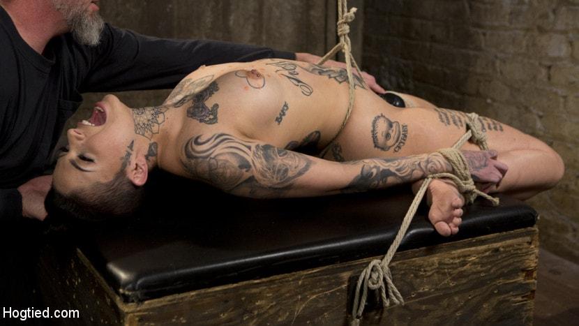 Kink 'Tattooed Pain Slut Endures Brutal Bondage with Agonizing Torment' starring Leigh Raven (Photo 15)