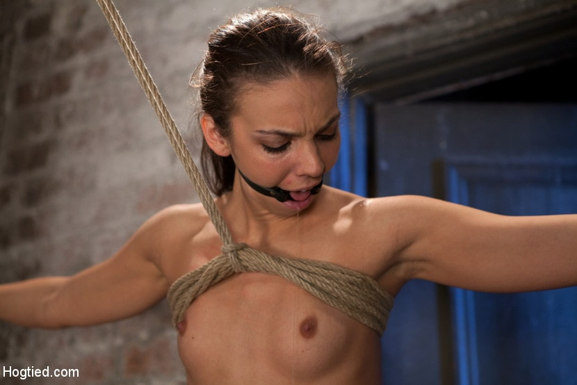 Kink 'It's her first hardcore Bondage shoot. She cums like a whore while gagged and suspended! Category 5' starring Tiffany Tyler (Photo 15)
